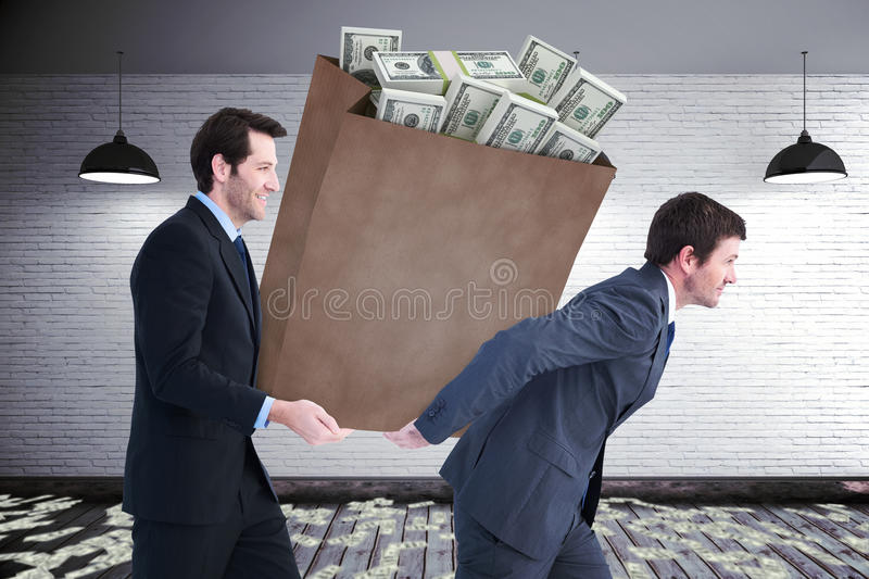 Composite image of businessmen carrying bag of dollars stock photos