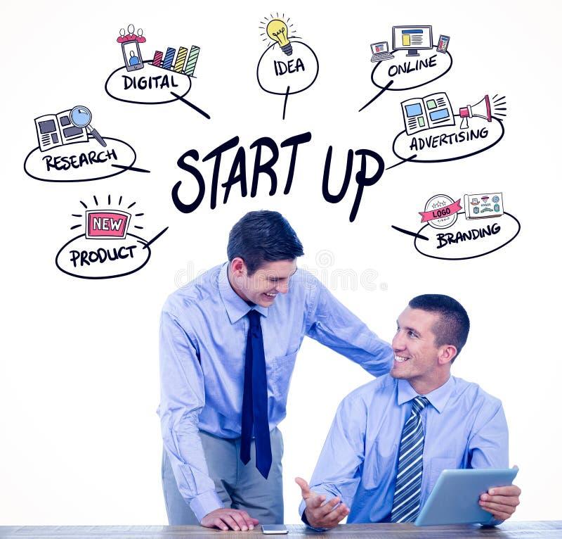 Composite image of businessmen using tablet. Businessmen using tablet against start up doodle stock images