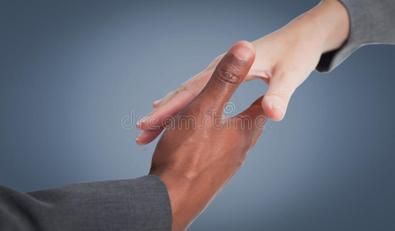 Composite image of businesspeople going to shake hands royalty free stock image