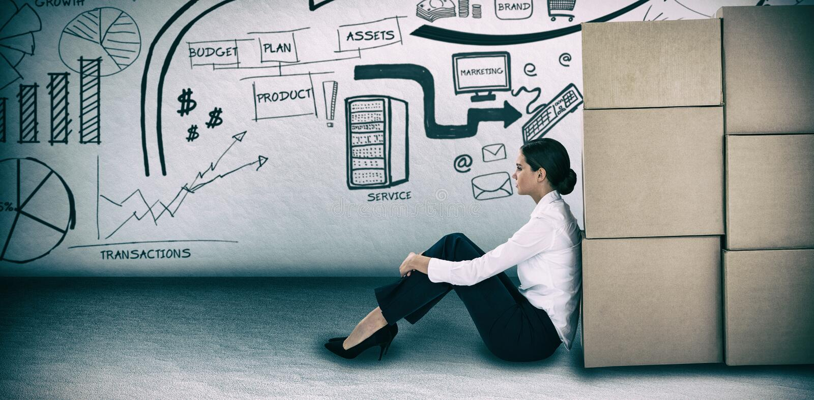 Composite image of businesswoman leaning on cardboard boxes against white background. Businesswoman leaning on cardboard boxes against white background against stock images