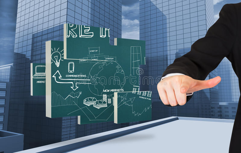 Composite image of businesswoman pointing. Businesswoman pointing against view of dull cityscape stock photo