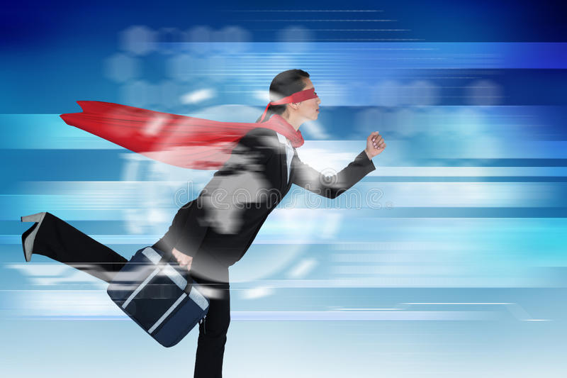 Composite image of businesswoman running while pretending to be super hero royalty free stock photography