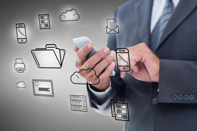 Composite image of businesswoman using smart phone. Businesswoman using smart phone against grey vignette stock photos