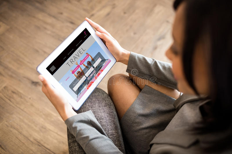 Composite image of businesswoman using tablet stock photos