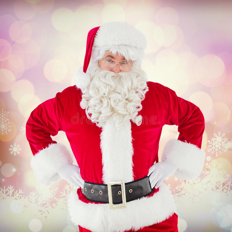 Composite image of cheerful santa claus with his hands on hips stock photography