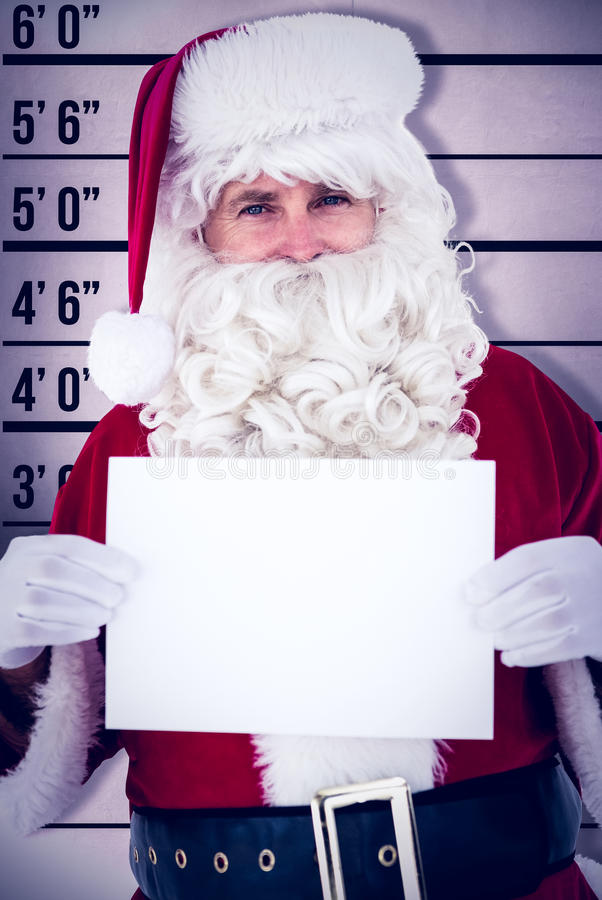 Composite image of cheerful santa claus holding page royalty free stock photography