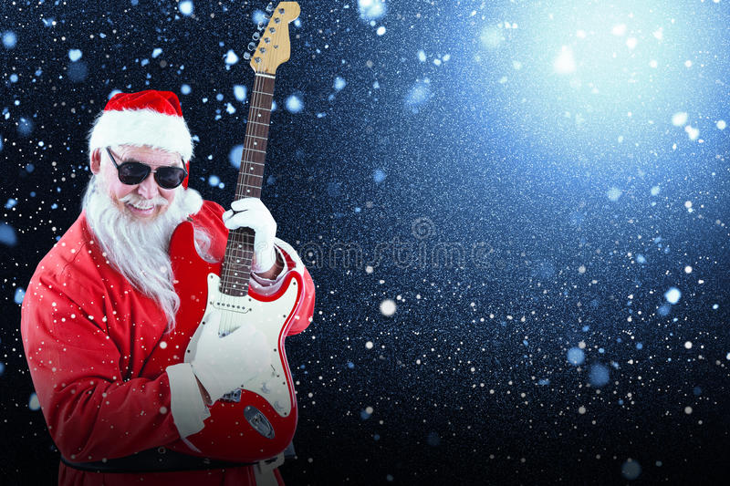 Composite image of cheerful santa claus playing guitar stock photography