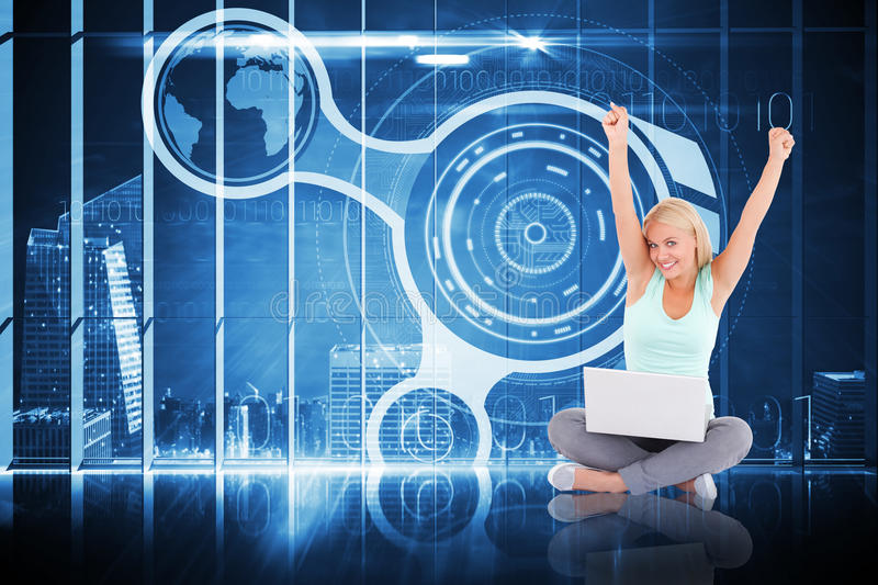 Composite image of cheering blonde using laptop. Cheering blonde using laptop against hologram interface in office overlooking city royalty free stock photography