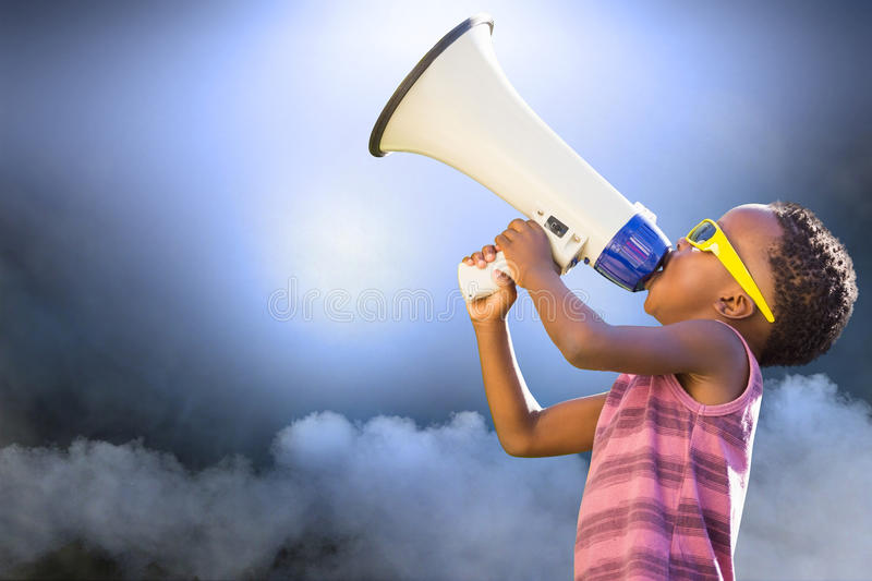 Composite image of child with megaphone stock photo