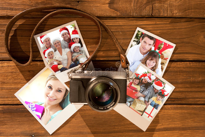 Composite image of children sitting with their family holding christmas boots. Children sitting with their family holding Christmas boots against chemical royalty free stock photo