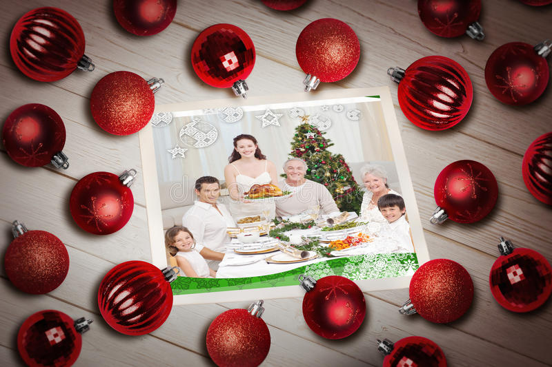 Composite image of christmas baubles on table royalty free stock photo