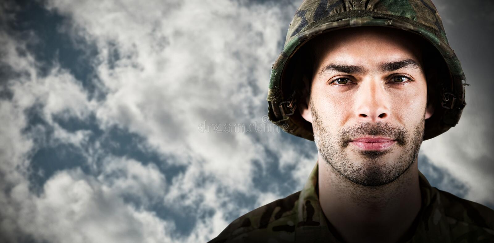 Composite image of close up of confident soldier wearing hard hat stock photos