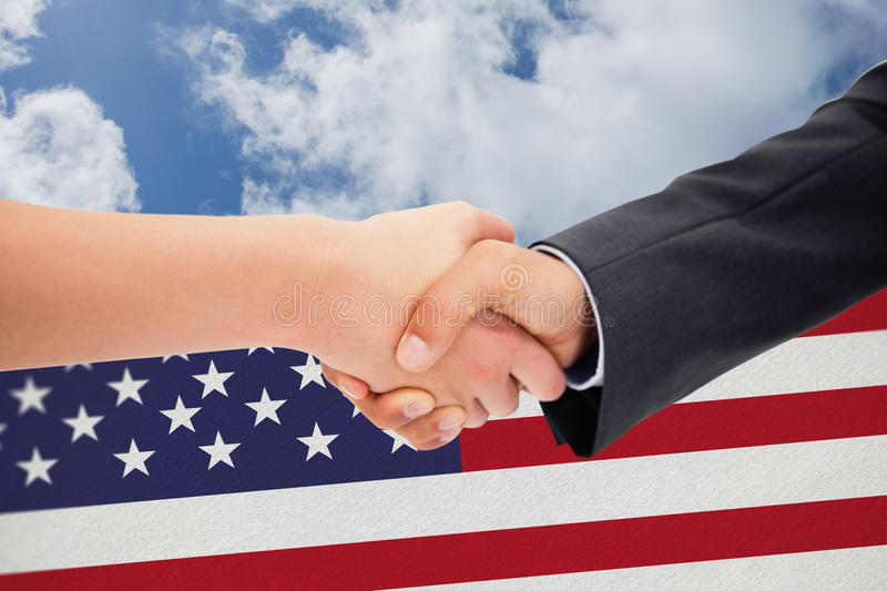 Composite image of close up of a handshake stock image