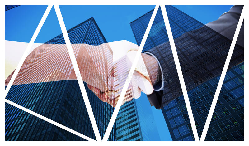 Composite image of close up of a handshake. Close up of a handshake against skyscraper stock images