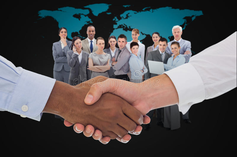 Composite image of close-up shot of a handshake in office. Close-up shot of a handshake in office against black world map royalty free stock photography