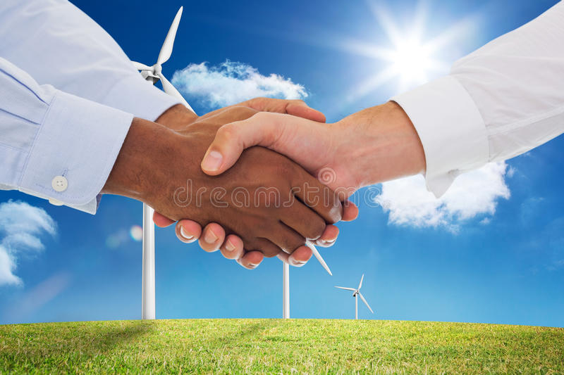Composite image of close-up shot of a handshake in office stock photo