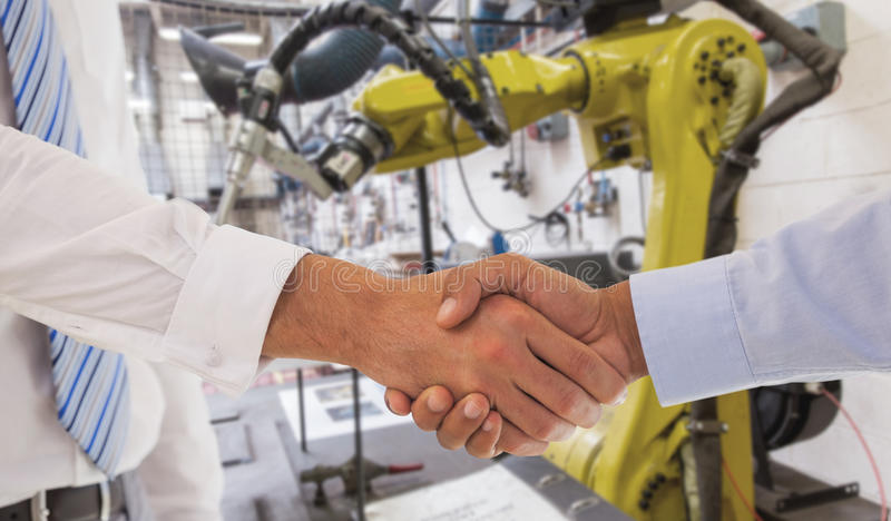 Composite image of close-up shot of a handshake in office stock image