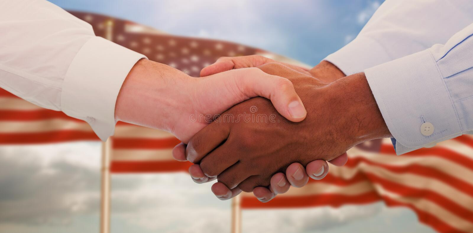 Composite image of close-up shot of a handshake in office royalty free stock image