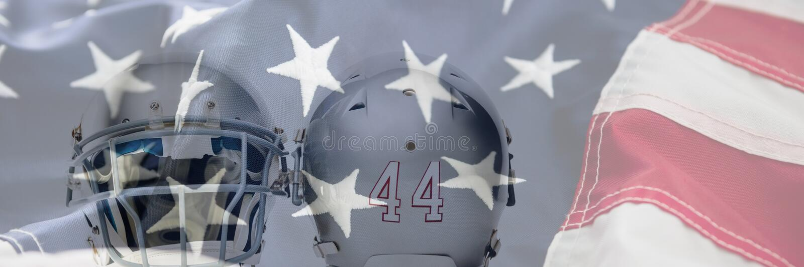 Composite image of close up of silver colored sports helmets. Close up of silver colored sports helmets against full frame of american flag royalty free stock photography