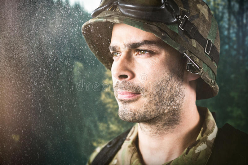Composite image of close up of thoughtful military soldier stock image