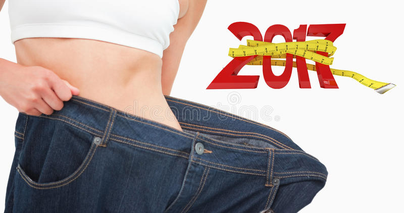 Composite image of close up of a woman waist who lost a lot of weight royalty free stock image