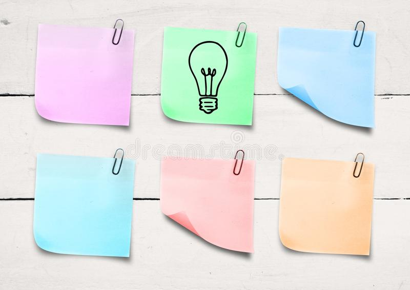 Composite image of colored Sticky Note Idea Bulb Icon. Digital composite of colored Sticky Note Idea Bulb Icon royalty free stock images