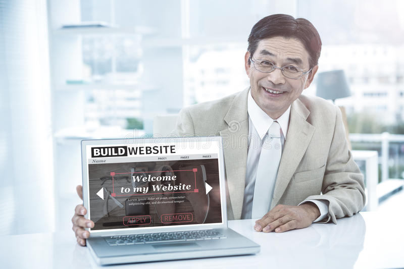 Composite image of composite image of build website interface. Composite image of build website interface against smiling asian businessman showing his laptop royalty free stock image