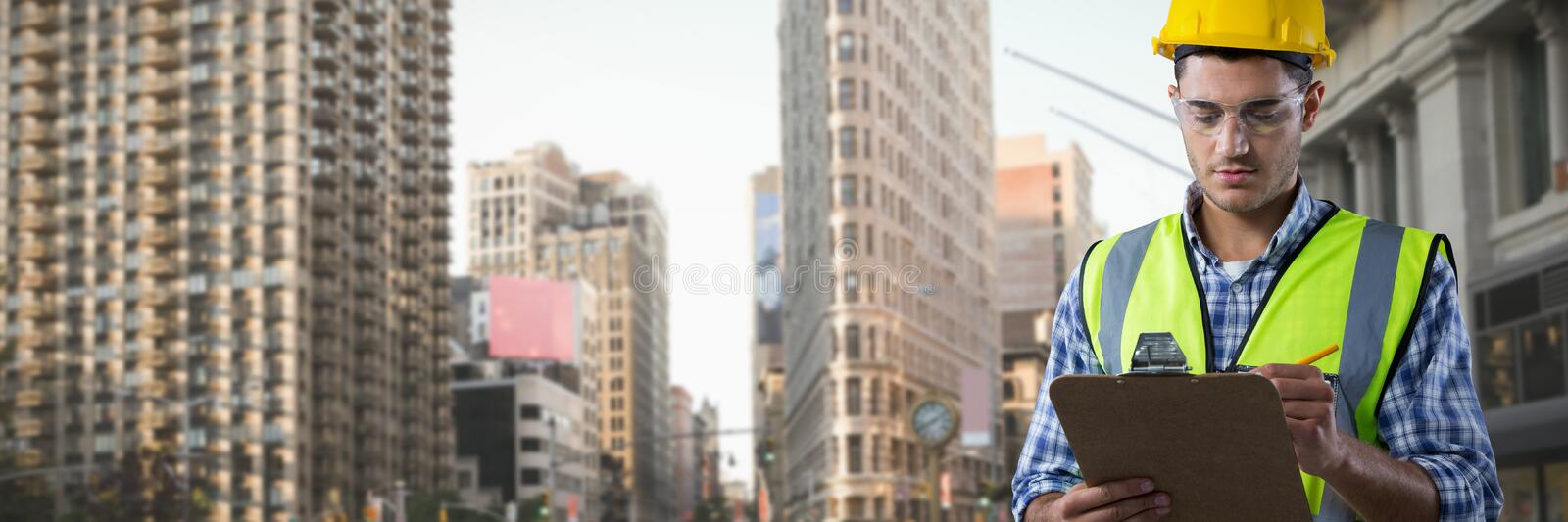 Composite image of concentrated construction worker stock photo