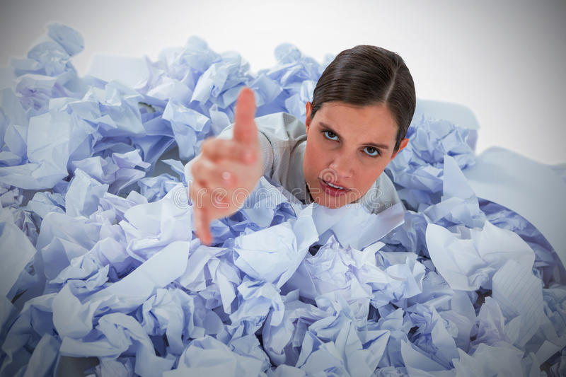 Composite image of conceptual image of woman in heap of crumple paper asking for help royalty free stock images