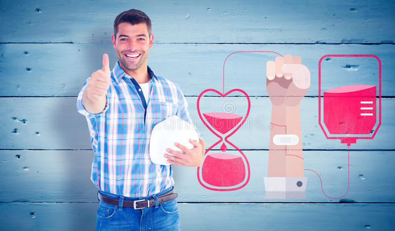 Composite image of confident manual worker gesturing thumbs up royalty free stock image
