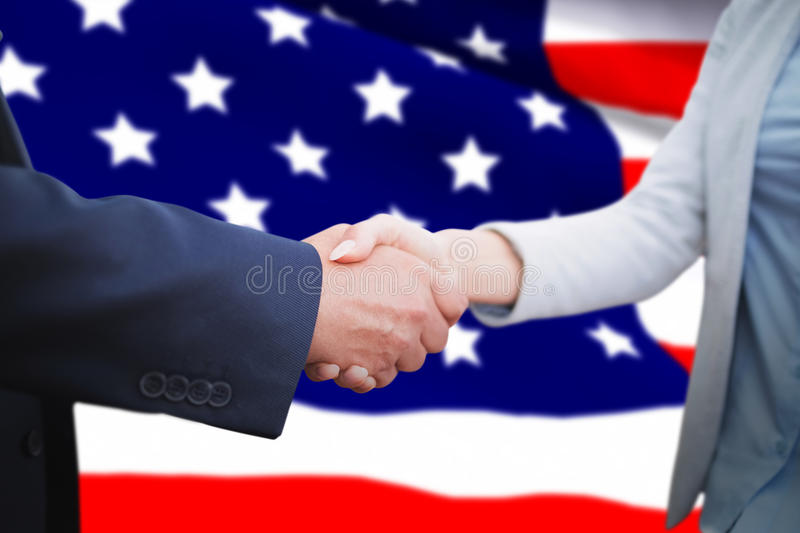 Composite image of corporate people doing handshake royalty free stock images