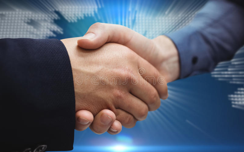 Composite image of corporate people shaking hands. Corporate people shaking hands against glowing world map on black background royalty free stock photography