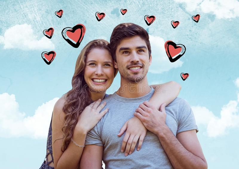 Composite image of couple embracing against sky with pink valentines hearts royalty free illustration
