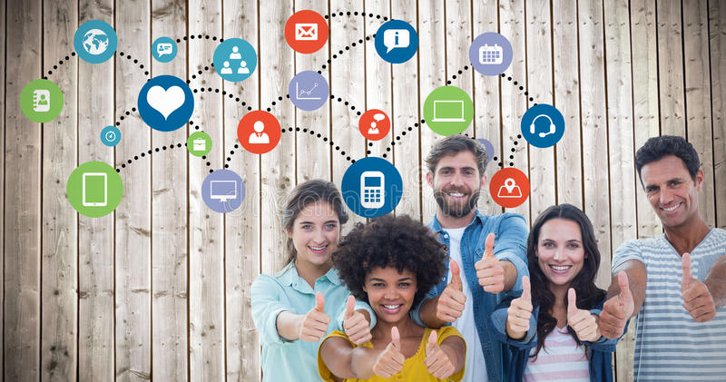 Composite image of creative business people gesturing thumbs up by blackboard. Creative business people gesturing thumbs up by blackboard against wooden planks royalty free stock image