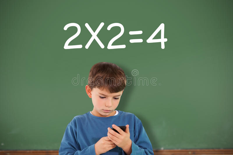 Composite image of cute boy using smartphone royalty free stock images