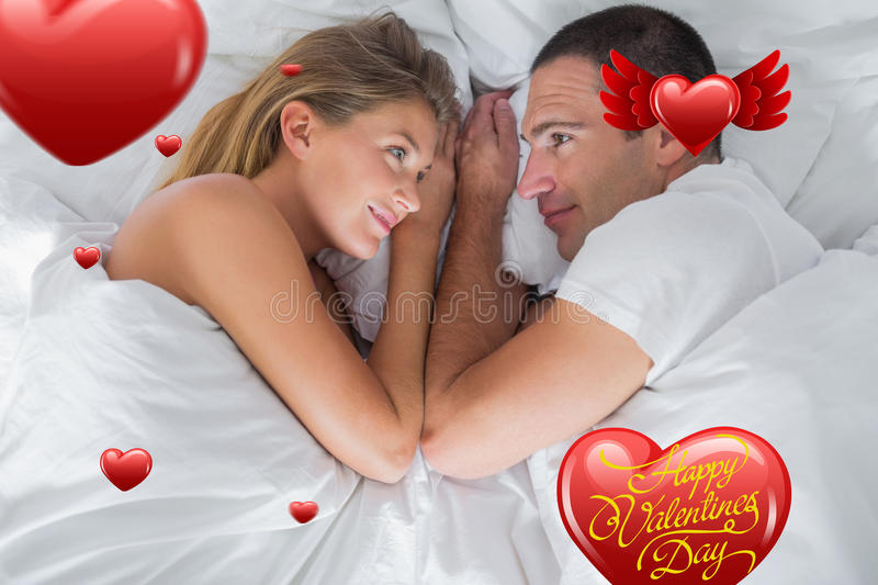 Composite image of cute couple lying and looking at each other in bed vector illustration