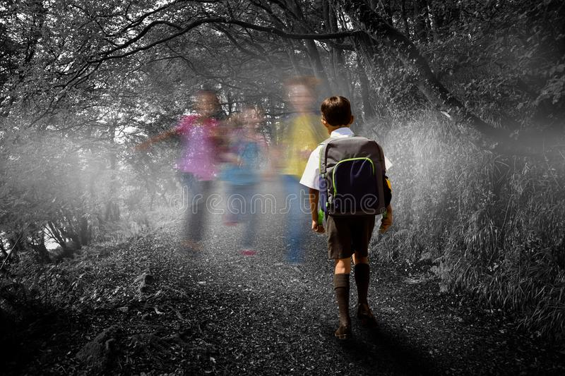 Composite image of cute pupil walking to the school bus. Cute pupil walking to the school bus against dark way in the woods royalty free stock photos
