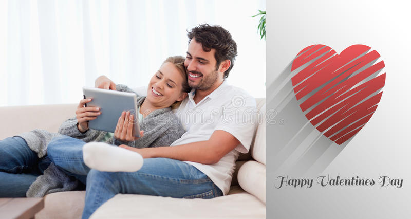 Composite image of cute valentines couple. In love couple using a tablet computer against cute valentines message royalty free illustration