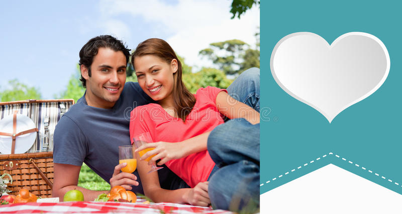Composite image of cute valentines couple. Two friends looking ahead while they hold glasses during a picnic against heart label vector illustration