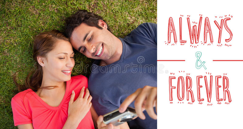 Composite image of cute valentines couple. Two smiling friends looking at photos on a camera against always and forever vector illustration
