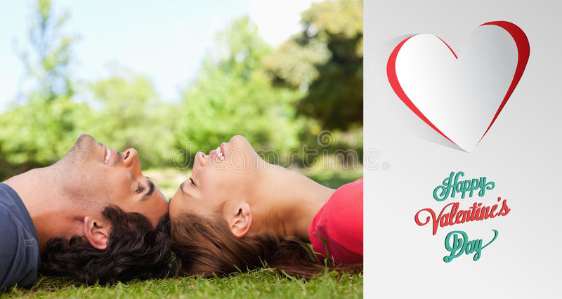 Composite image of cute valentines couple. Two smiling friends with their eyes closed while lying head to head against cute valentines message royalty free illustration