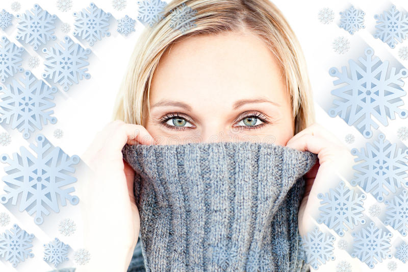 Composite image of delighted woman wearing a poloneck-sweater smiling at the camera stock images