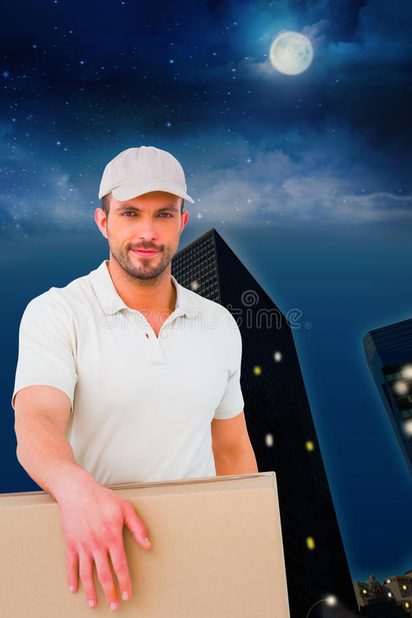 Composite image of delivery man carrying package stock photos