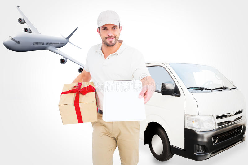 Composite image of delivery man giving clipboard for signature royalty free stock image