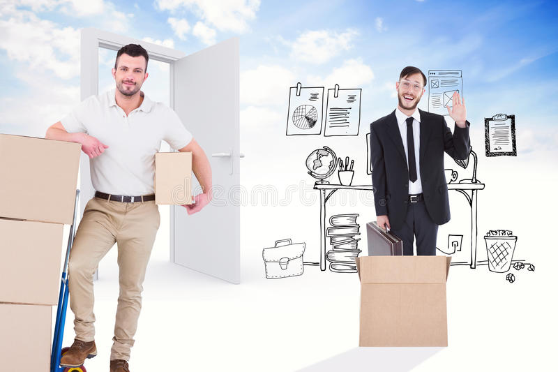 Composite image of delivery man with trolley of boxes royalty free stock images
