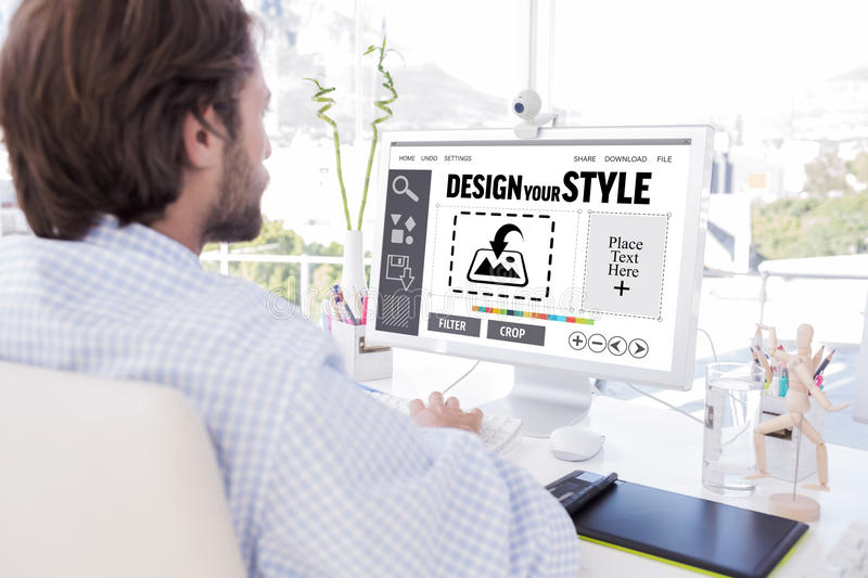 Composite image of desinger working on his computer royalty free stock images