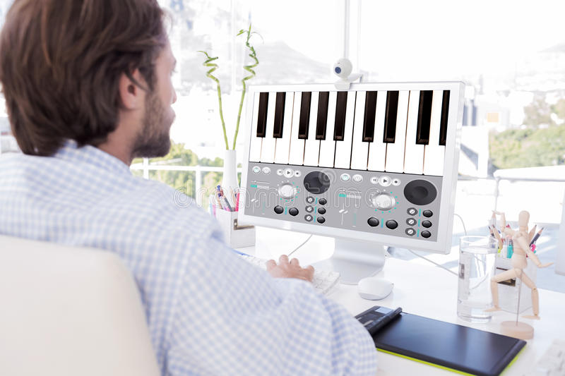 Composite image of desinger working on his computer royalty free stock image