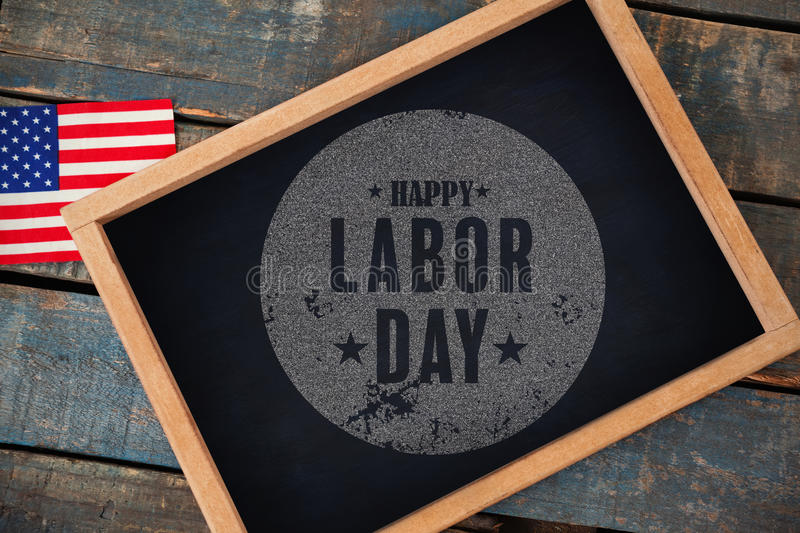 Composite image of digital composite image of happy labor day text poster. Digital composite image of happy labor day text poster against overhead view of royalty free stock image