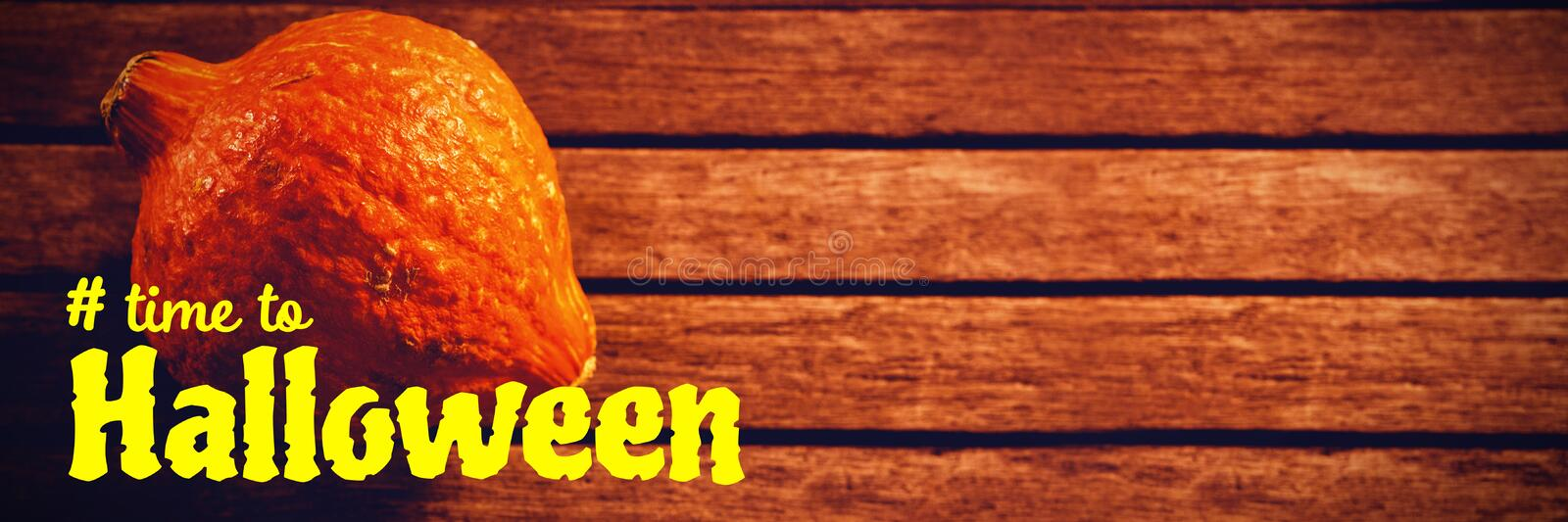 Composite image of digital image of time to halloween text. Digital image of time to Halloween text against squash on wooden table during halloween royalty free stock images