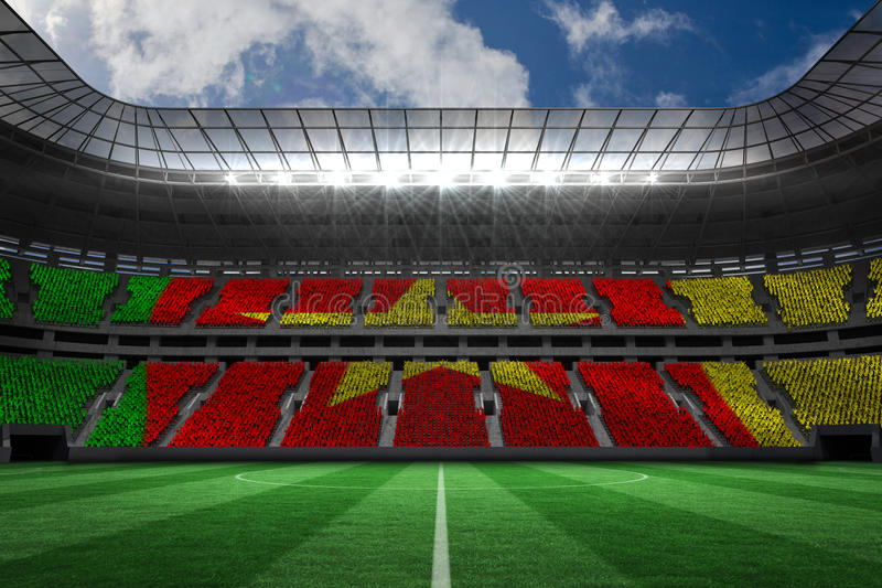 Composite image of digitally generated cameroon national flag. Digitally generated cameroon national flag against large football stadium with white fans royalty free illustration